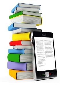 Pila di libri con smartphone